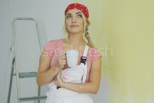 Female painter in overalls resting with drink  Stock photo © dash