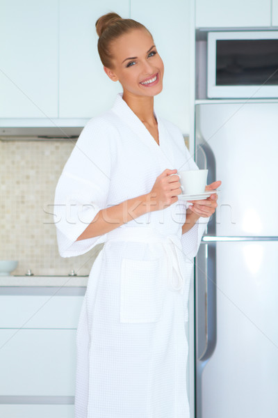 Woman in white robe drinking coffee Stock photo © dash