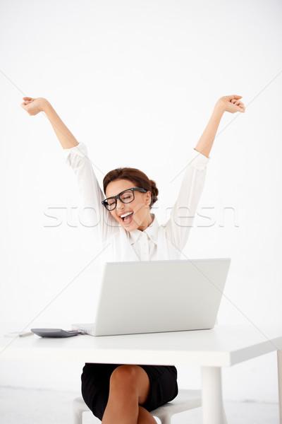 Jungen Buchhalter Schreibtisch angehoben Arme weiblichen Stock foto © dash