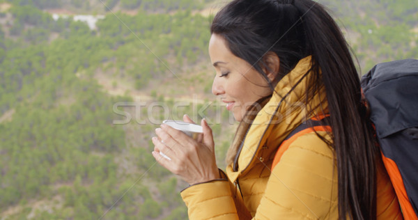 Young woman backpacker savoring her coffee Stock photo © dash