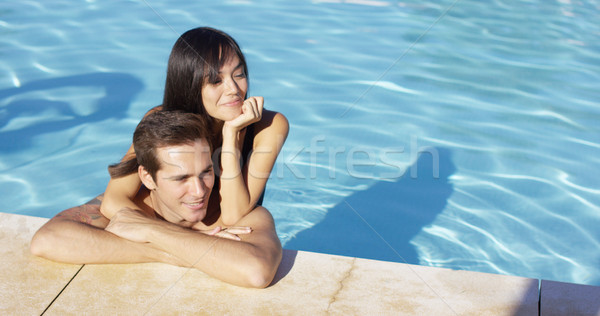 Woman hugs boyfriend and rests elbow on shoulder Stock photo © dash