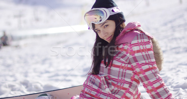 Beautiful asian snowboarder sitting on snow Stock photo © dash