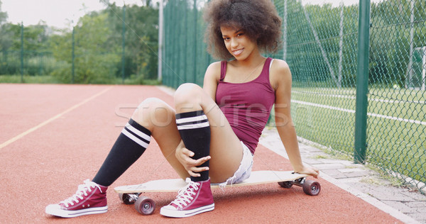 Flirty woman on skateboard Stock photo © dash