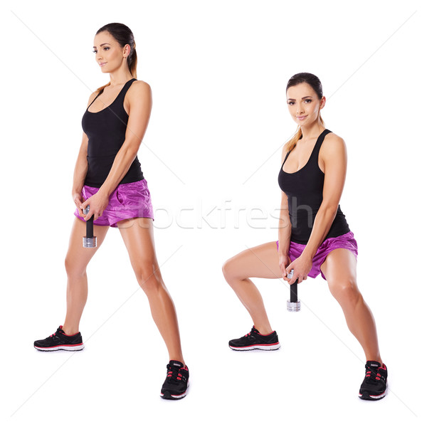 Stock photo: Female athlete working with dumbbells