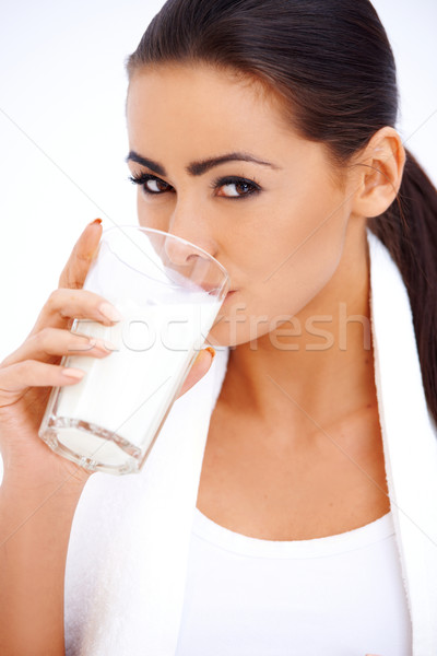 Woman is drinking milk from a glass Stock photo © dash