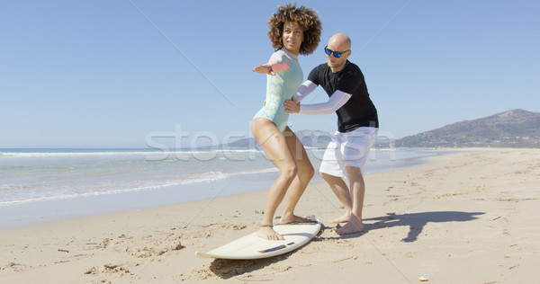 Man teaching woman standing on surf Stock photo © dash