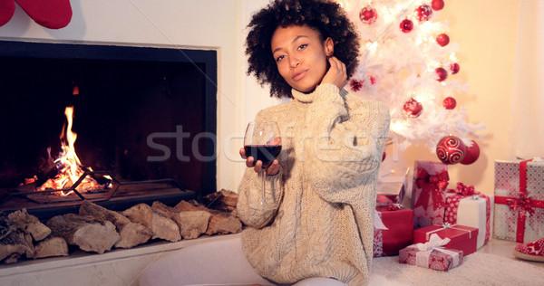 Güzel kadın şarap kadehi şömine güzel Stok fotoğraf © dash