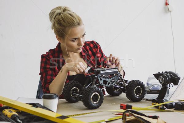 Female repairing radio-controlled car  Stock photo © dash