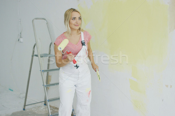 Blond female with paint roller dancing  Stock photo © dash