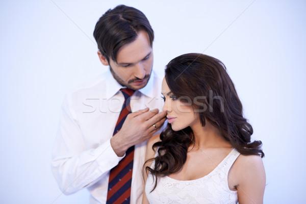 Loving man stroking a womans cheek Stock photo © dash