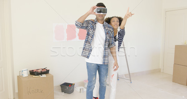 Man using virtual reality glasses gets help Stock photo © dash