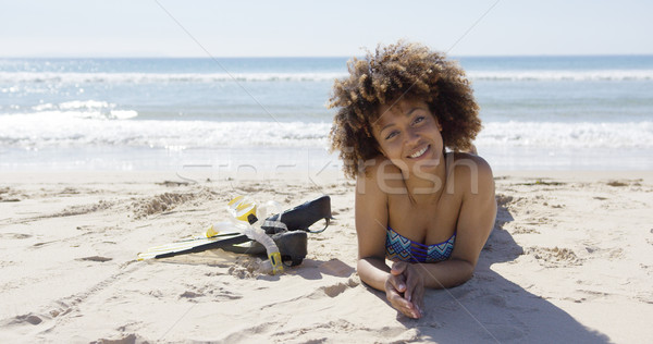 Female lying on beach with flippers Stock photo © dash