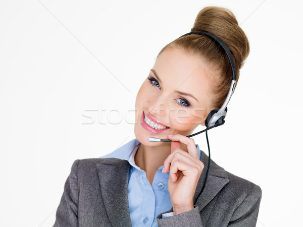 Smiling elegant businesswoman in a headset Stock photo © dash