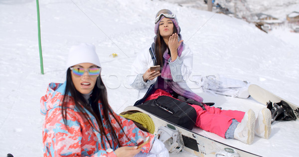 Two attractive women snowboarders relaxing Stock photo © dash
