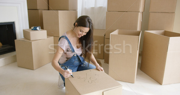 Pretty woman packing up her personal belongings Stock photo © dash
