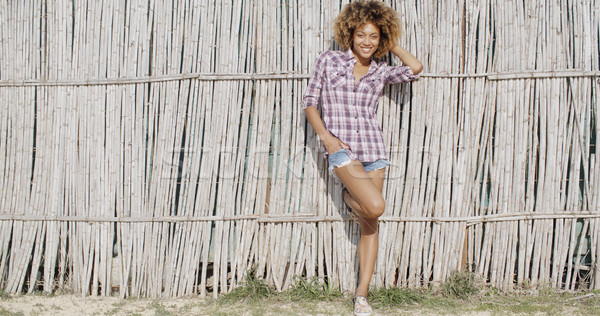 Young Woman Near A Wattled Fence Stock photo © dash