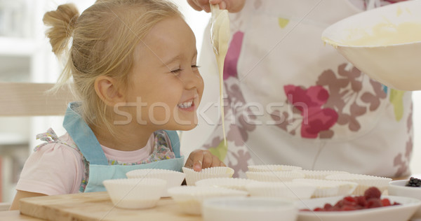 Happy little girl with empty muffin holders Stock photo © dash