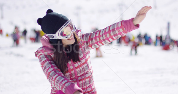 Happy woman on ski holiday waving Stock photo © dash