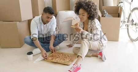 Attractive couple unpacking their things in new home Stock photo © dash