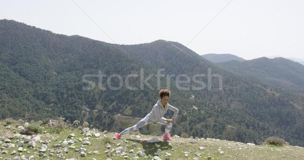 Kadın kaya uçurum genç kadın Stok fotoğraf © dash