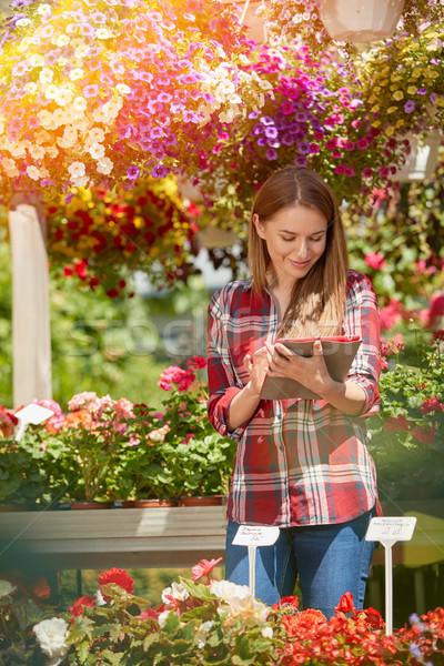 Gardener using tablet Stock photo © dash