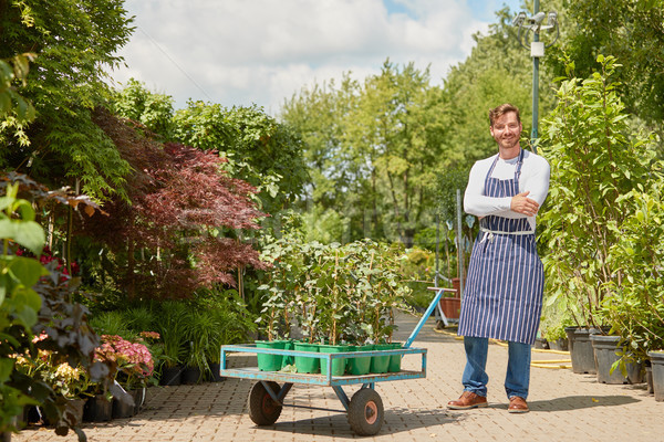 Cheerful gardener with wagon Stock photo © dash