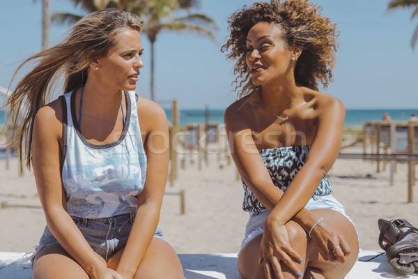Relaxed women spending time on shoreline Stock photo © dash