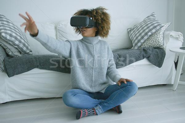 Woman enjoying VR glasses Stock photo © dash