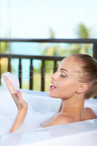 Woman blowing bubbles in bubblebath Stock photo © dash