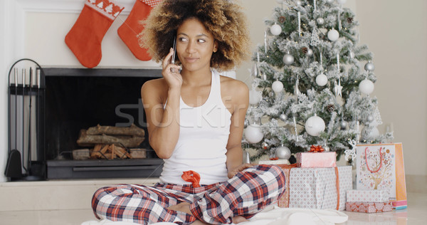 Attractive woman phoning her friends at Christmas Stock photo © dash