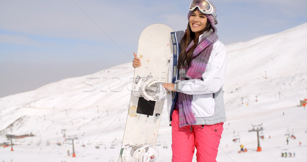 Smiling gorgeous woman posing with her snowboard Stock photo © dash