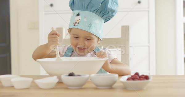 Adorable smiling toddler at mixing bowl Stock photo © dash