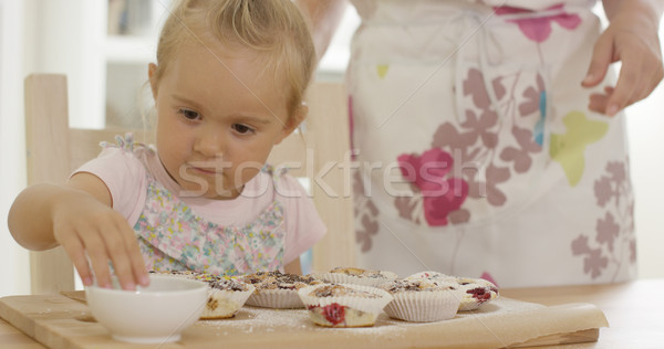 Close up on girl helping to prepare muffins Stock photo © dash