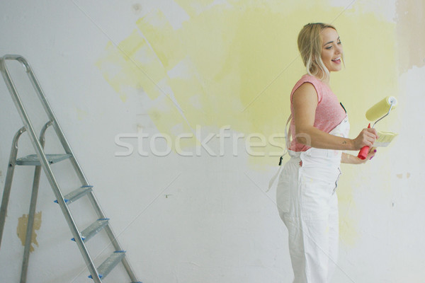 Dancing female painter with roller Stock photo © dash