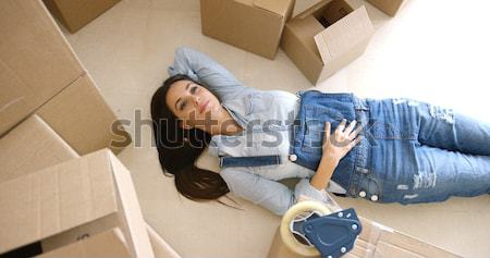 Young woman relaxing on the floor after packing Stock photo © dash