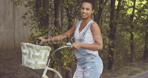 Woman posing with bicycle at street Stock photo © dash