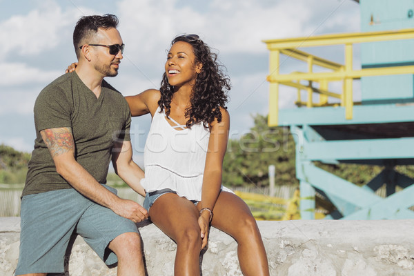 Laughing stylish couple on seafront Stock photo © dash