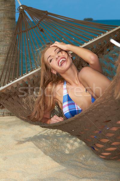 High-spirited laughing woman in hammock Stock photo © dash