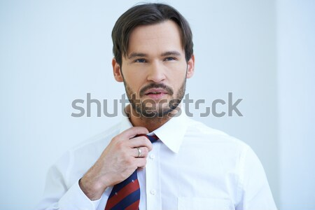 Thoughtful young businessman Stock photo © dash