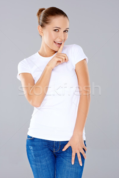 Játékos fiatal nő kérdez titkolózás csendes mosolyog Stock fotó © dash