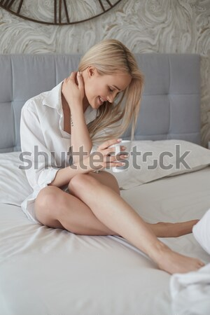 Young woman relaxing on a sofa with tablet Stock photo © dash