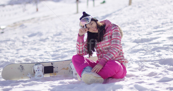 Young woman on ski slope with snowboard Stock photo © dash