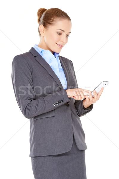 Nő olvas sms mobiltelefon elegáns profi Stock fotó © dash