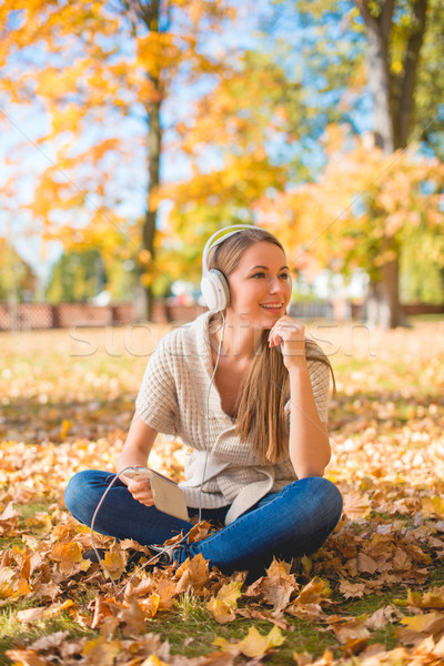 Young woman relaxing listening to music Stock photo © dash