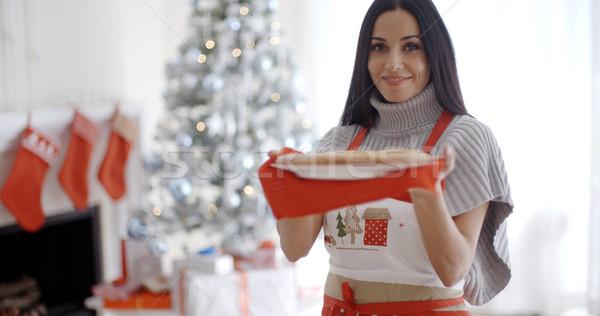 Fiatal nő sütés karácsony csemegék áll ünnepi Stock fotó © dash