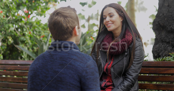 Young man squatting down talking to his girlfriend Stock photo © dash
