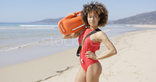 Vrouwelijke poseren redding strand badmeester Stockfoto © dash