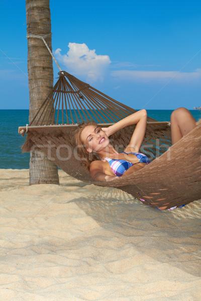 Woman enjoying the peace of a tropical beach Stock photo © dash