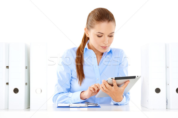Dedicated young businesswoman Stock photo © dash