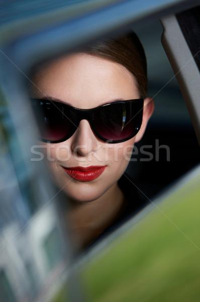 Macro Smiling Face Inside A Car Stock photo © dash